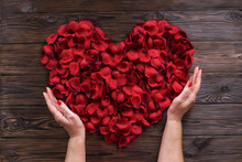 Woman Holds Red Rose Petals He...