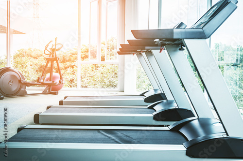 Canvas Print Fitness hall with the sport bikes and treadmill in it health concept