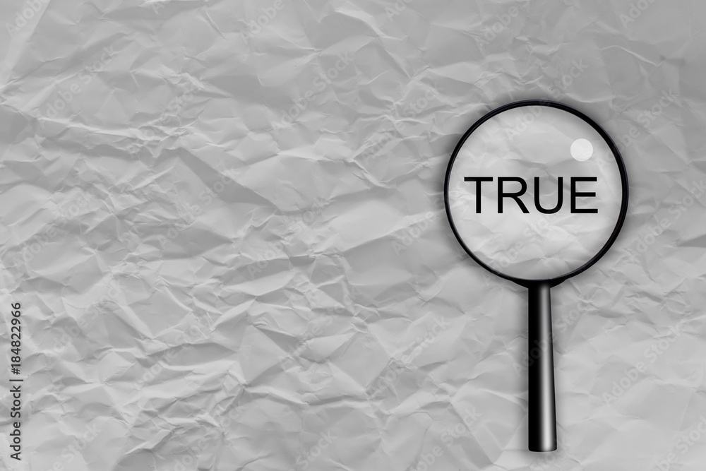 Fototapeta True text concept. Crumpled fold white paper sheet background with magifying glass check true word with free copy space for your creativity ideas text  business concept