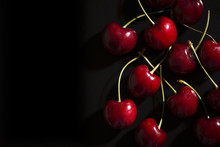 Raw Cherries On Black Background