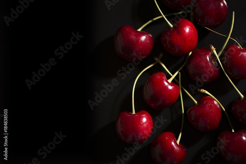 Raw cherries on black background Canvas-taulu