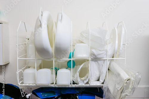 Photo Bedpans and urine bottles in the sluice of a hospital