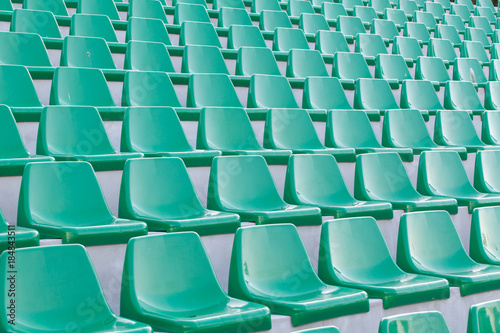 Papiers peints Stade de football plastic blue seats on football stadium