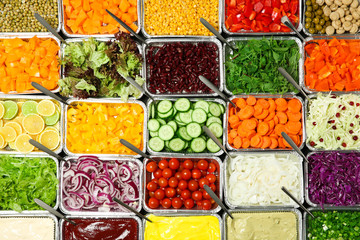 Fototapeta Do baru Top view of salad bar with assortment of ingredients