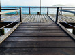 Perspective view wooden pier on the blue sea beach, summer time.