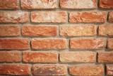 Fototapeta Do akwarium - The wall is made of red brick.