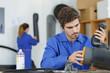 apprentice mechanician manipulating part