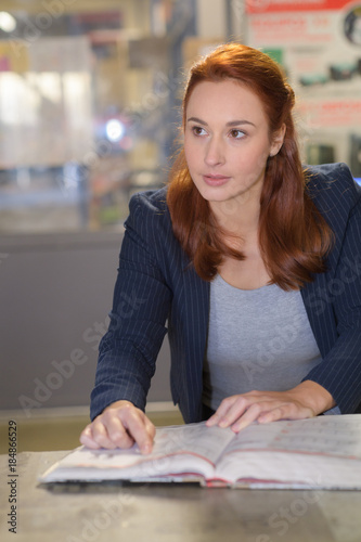 Lady sat with open directory Canvas Print
