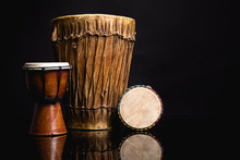 Three Old Handmade Djembe Drums Isolated On Black