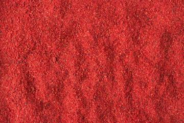 Fototapeta hot chili pepper powder spice as a background, natural seasoning texture