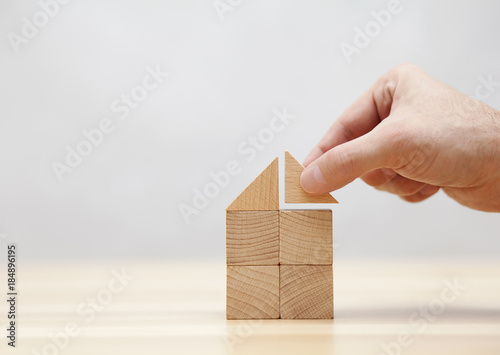 Fotografia Hand building house with wooden blocks