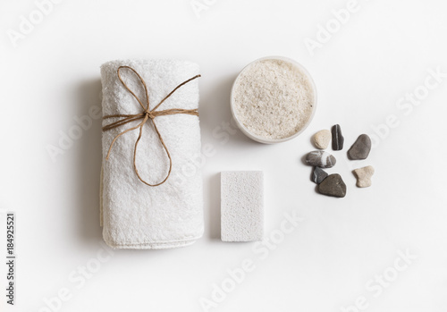 Cadres-photo bureau Spa Beauty and spa concept. Towel, sea salt, pumice and stones on white paper background. Flat lay.
