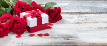 Red Roses And Gift For Valenti...