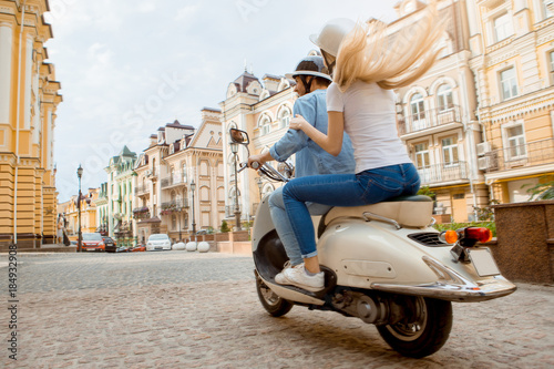 Fotografija Young couple on scooter travel together transportation