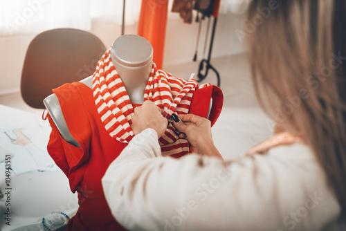 Fotografie, Obraz  Creating Dress On A Mannequin