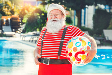 Santa Claus Near The Pool Holiday Vacation Concept