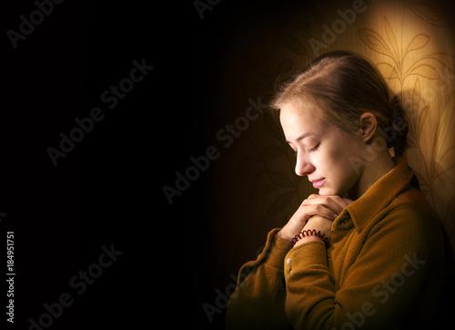 Fotografija Young woman praying