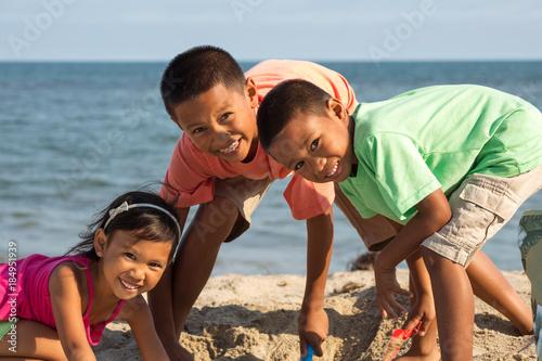 Fotografie, Obraz  Happy kids playing on the beach.