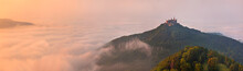 German Castle Burg Hohenzollern Over The Clouds At Sunset Landscape