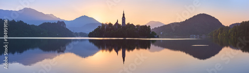 Church and Castle in lake Bled, Slovenia at sunset, scenic summer panorama