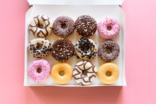 Box Of Fancy Donuts With Sprin...