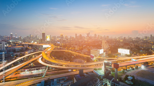 Night city downtown and highway with sunset tone, cityscape background