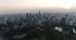 BANGKOK, THAILAND, MARCH 2017: Aerial view over Central Bangkok and Lumpini park at sunset