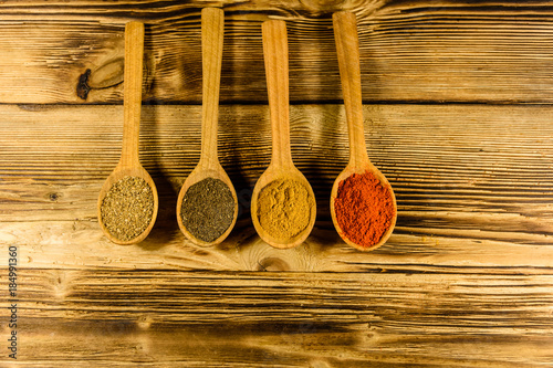 Canvas Prints Spices Spoons with the different spices on wooden table. Top view