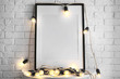 canvas print picture - Mockup of blank frame with garland on table