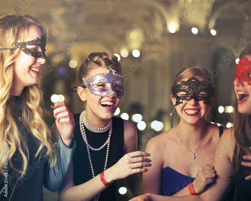 Canvas Prints Carnaval Group of masked girls laughing