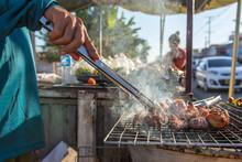 Lao Street Vendor Frying Meat ...