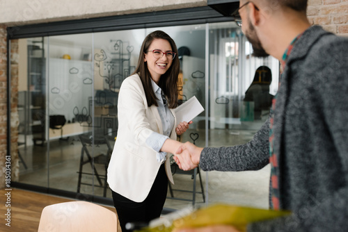 Photo  Openly greeting a job recruiter with a firm handshake