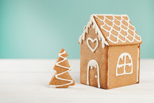 Gingerbread House And Gingerbread Tree On A Light Background, Copy Space