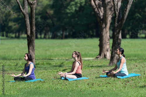 In de dag Kamperen Activities in family, mother and daughter on a yoga mat to relax in the park outdoor, Concept of healthy lifestyle and relaxation.
