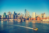 Fototapeta Nowy Jork - Brooklyn bridge and Manhattan at sunny day, New York City