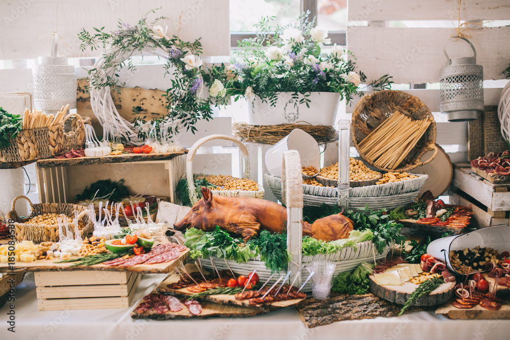 Fototapeta Meat, cheese and nutmeg wedding buffet with various snacks.