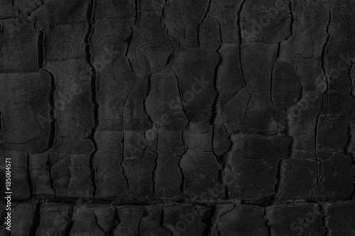 Aluminium Prints Firewood texture Black grunge background. Burnt wood texture.