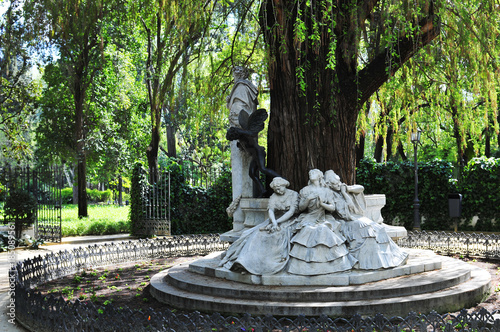 Fototapeta Beautiful monument dedicated to poet Gustavo Adolfo Becquer located in the north of the Maria Luisa Park in Seville, Spain