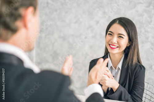 Boss/Business man employer admires young Asian business woman/staff/employee by thumb up and clap with smiling face for her success and good/best in work and recognition/appreciate Canvas Print