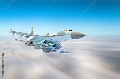 obraz lub plakat Military fighter aircraft at high speed, flying high in the sky.