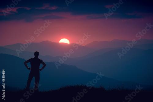 Foto op Plexiglas Crimson Silhouette of human standing on a hill