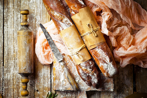 Papiers peints Affiche vintage Bread and pastries in a composition with kitchen accessories on an old background