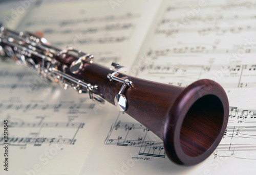 Clarinet instrument on musical notes, detail view Fototapeta