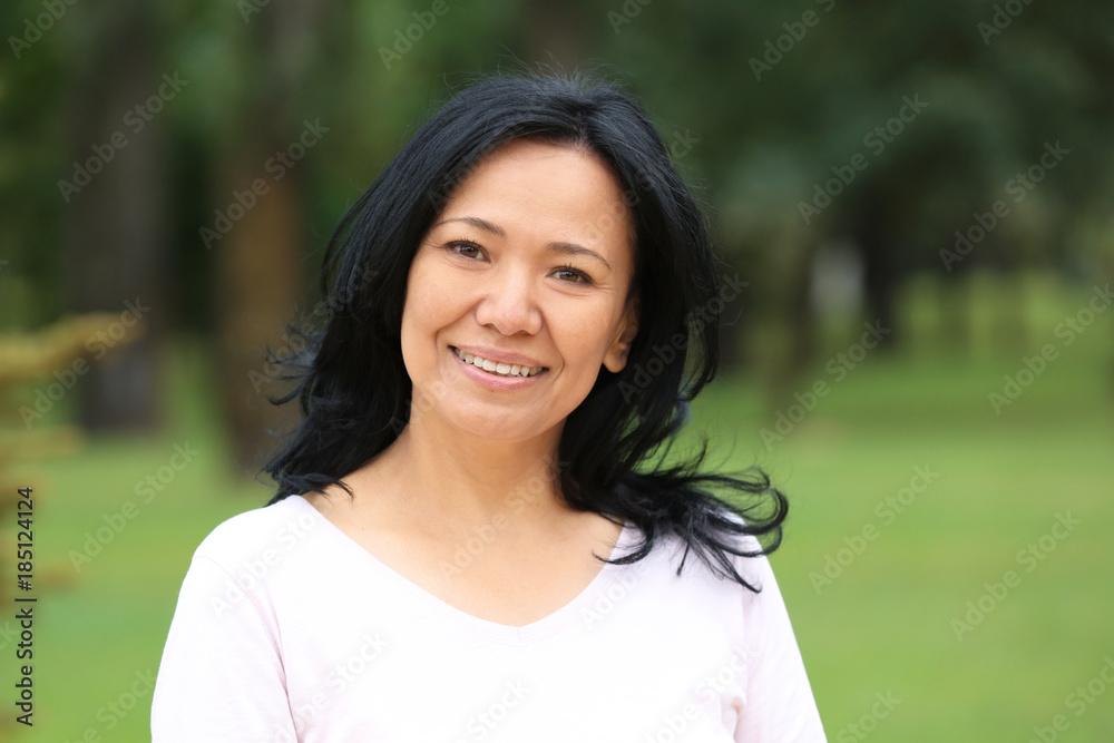 Fototapety, obrazy: Beautiful mature woman outdoors