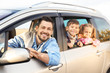 Young man with children in car, outdoors