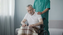 Paralyzed Pensioner In Wheelchair Shows No Reaction To Nursing House Employee