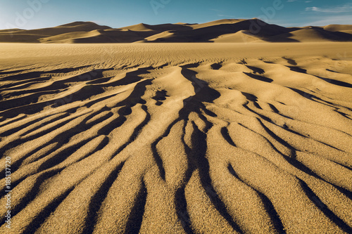 Tranquil view of wave pattern on sand at Great Sand Dunes National Park against sky
