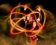 Woman Juggler Carries Out Show With Hoops
