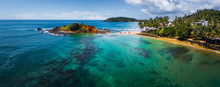 Aerial Panorama Of The Tropical Beach And Clear Sea With Coral Reefs In The Town Of Mirissa, Sri Lanka