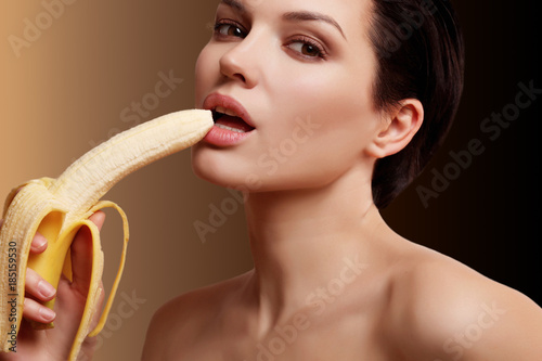 beautiful and sexy woman with a banana in her hand, contatsection, gradient